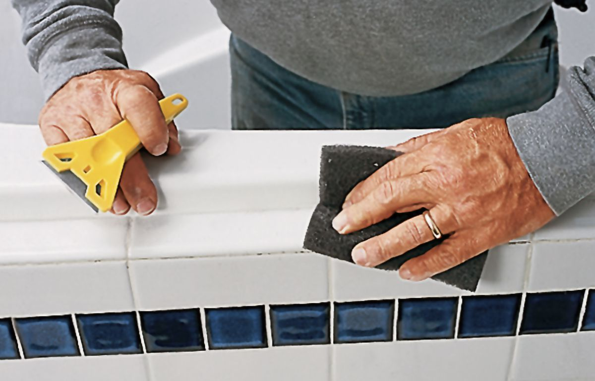 Scrub Caulk Residue With Nonabrasive Pad