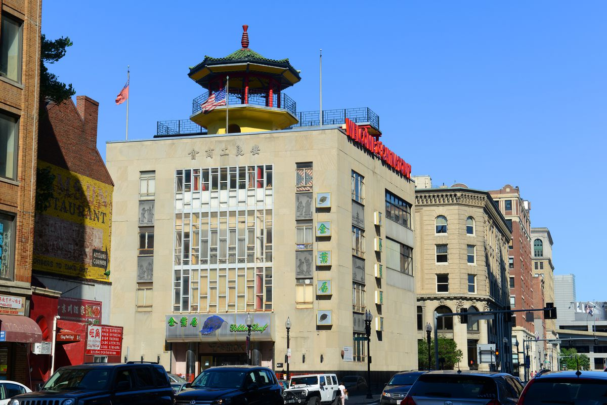 A five-story urban building crowned by a pagoda.