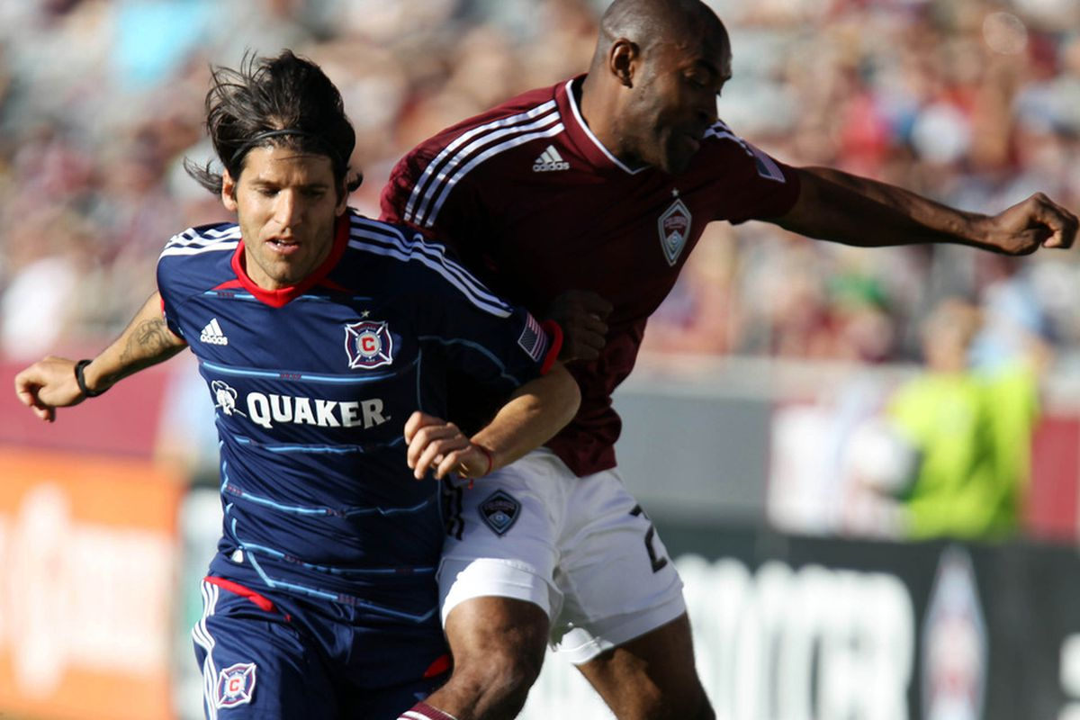 April 1, 2012; Commerce City, CO, USA; Chicago Fire midfielder Sebastian Grazzini (left) collides with Colorado Rapids defender Marvell Wynne at Dick's Sporting Goods Park. Mandatory Credit: Andrew Carpenean-US PRESSWIRE