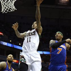 Milwaukee Bucks' Monta Ellis (11) drives between New York Knicks' Tyson Chandler (6) and Carmelo Anthony (7) during the second half of an NBA basketball game on Wednesday, April 11, 2012, in Milwaukee.