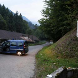 Gendarmes block access to a killing site near Chevaline, French Alps, Wednesday Sept. 5, 2012.  French authorities say at least four people have been shot to death in a forest in the Alps.An official with the regional administration for the Haute-Savoie region says three of the bodies were found in a BMW registered in Britain.