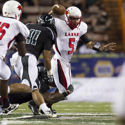 Lamar quarterback Ryan Mossakowski gets sacked by the Hawaiian defense during the second quarter of the NCAA game between the Lamar and Hawaii, Sept. 15, 2012 in Honolulu.