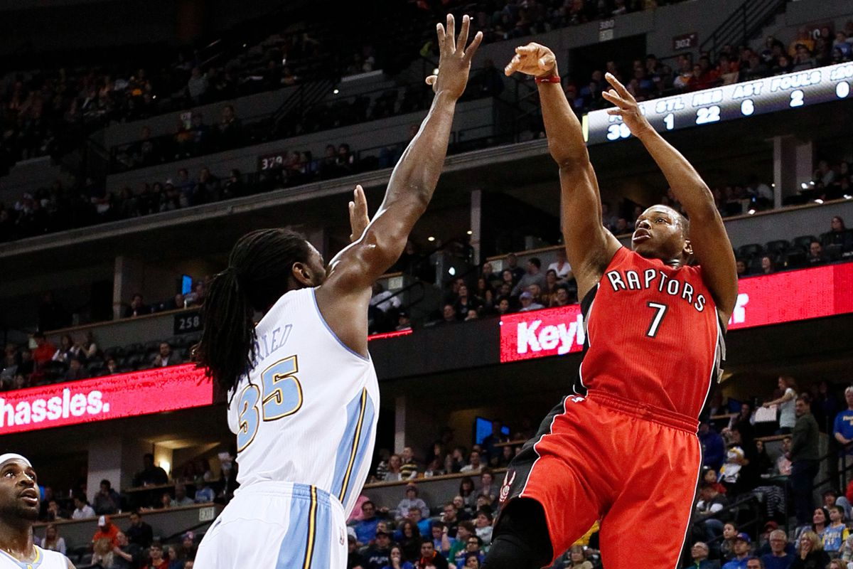 Kyle Lowry shoots over Kenneth Faried