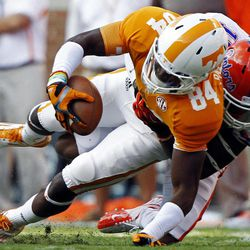 Tennessee wide receiver Cordarrelle Patterson (84) is tackled by Florida defensive back Loucheiz Purifoy (15) in the first quarter of an NCAA college football game, Saturday, Sept. 15, 2012, in Knoxville, Tenn.