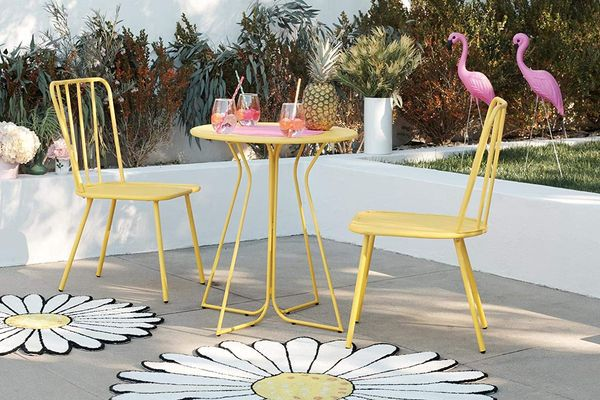2 yellow chairs and bistro table on patio