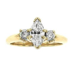 """<b>E.B. Horn</b> 14kt Yellow Gold Marquise Center with 2 Brilliant Cuts, <a href=""""http://www.ebhorn.com/item/14kt-yellow-gold-marquise-center-w2-brilliant-cuts"""">$2475</a>"""