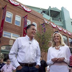 Republican presidential candidate, former Massachusetts Gov. Mitt Romney and his wife Ann stand outside Fenway Park baseball stadium in Boston, Monday, April 16, 2012.