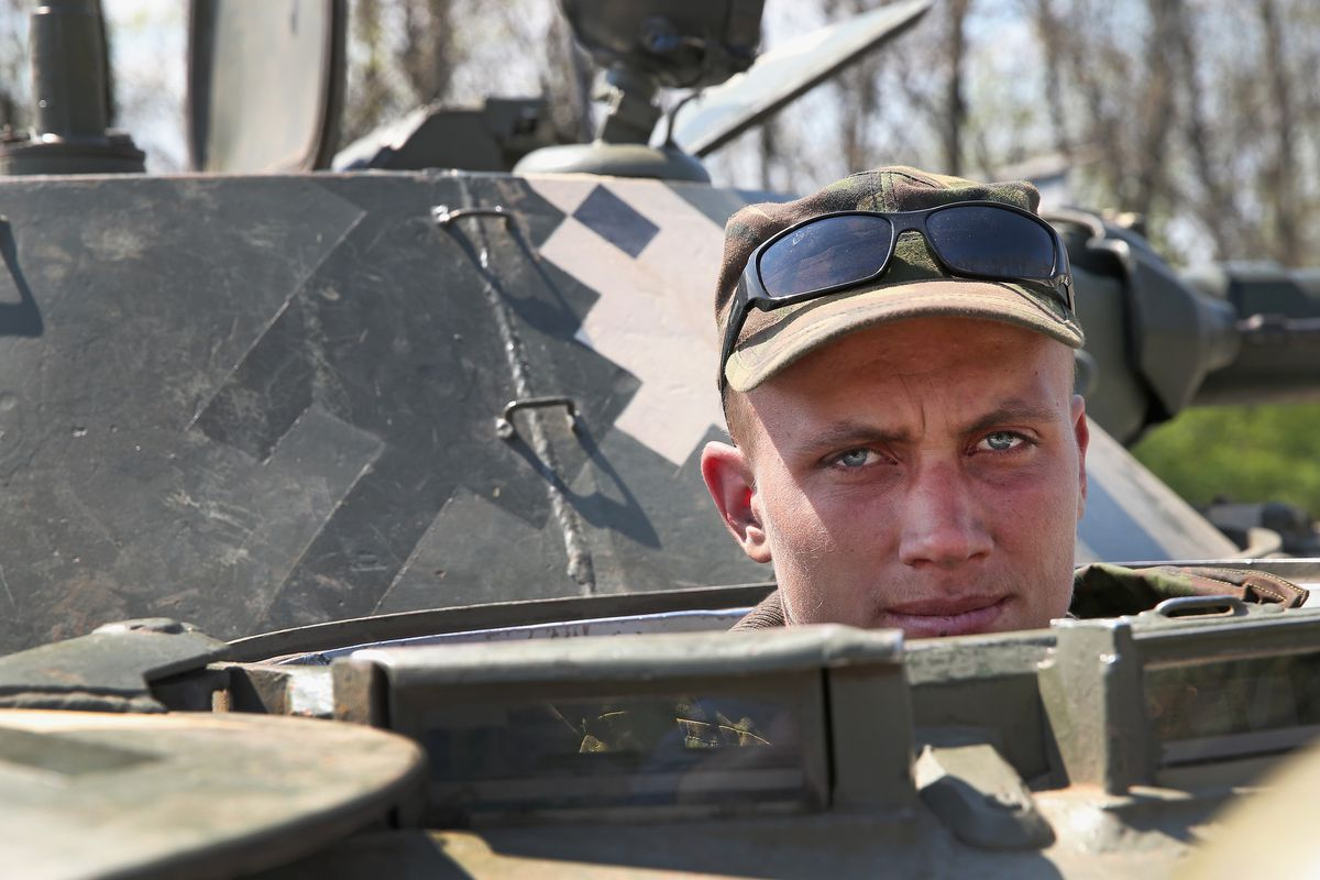 A Ukrainian troop guards a checkpoint near the contested city of Slavyansk
