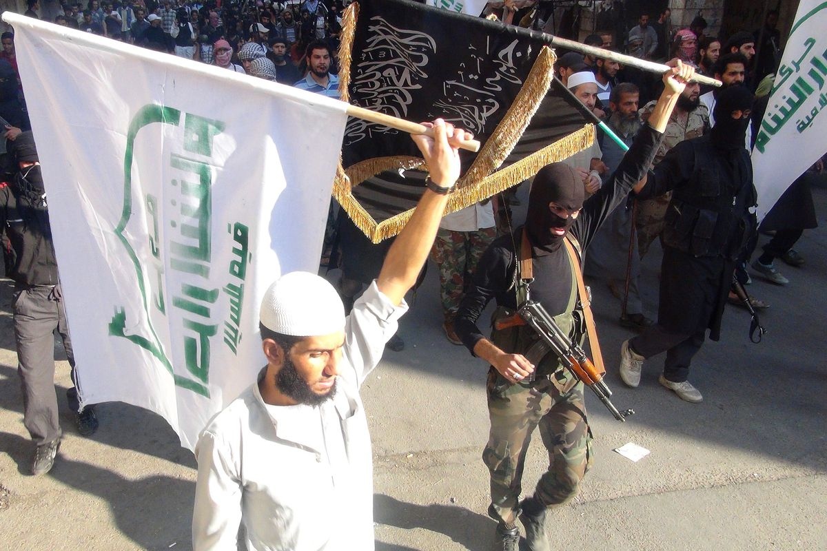 Jabhat al-Nusra fighters march with other Islamist groups.