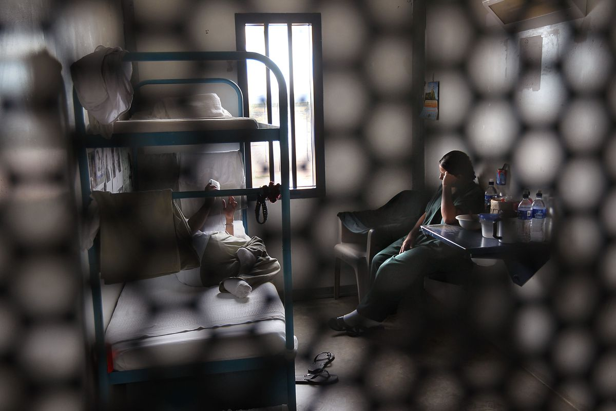 Immigrants sit in their housing cell in the women's wing of an Arizona detention facility for unauthorized immigrants.