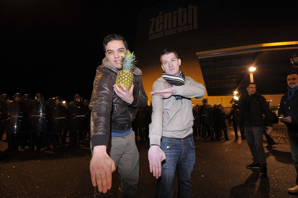 Two men perform a quenelle in western France in 2014.