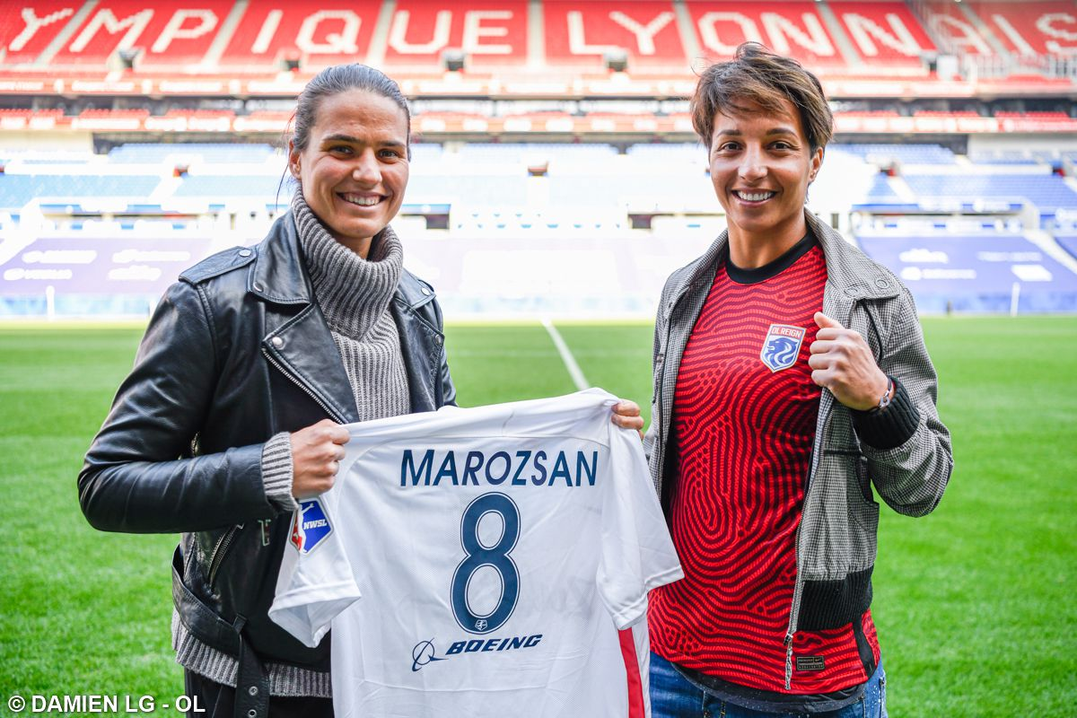 German midfielder Dzsenifer Marozsán and French goalkeeper Sarah Bouhaddi pose with OL Reign jerseys as part of the club's announcement of their upcoming loan spells to the NWSL club this summer.
