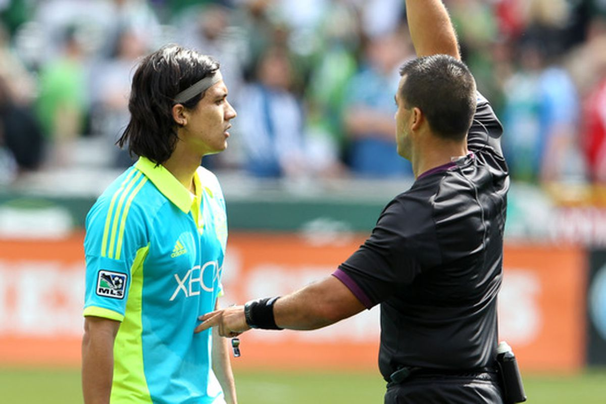 PORTLAND, OR - JUNE 24:Freddie Montero #17 of the Seattle Sounders is red carded against the Portland Timbers of during their game on June 24, 2012 at Jeld-Wen Field in Portland, Oregon.(Photo by Tom Hauck/Getty Images)