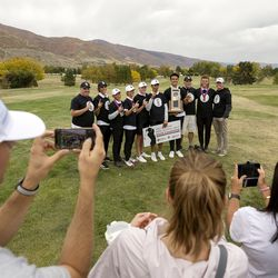 Lone Peak players and coaches pose for photos after winning the 6A boys state tournament at Davis Park Golf Course in Kaysville on Tuesday, Oct. 5, 2021.