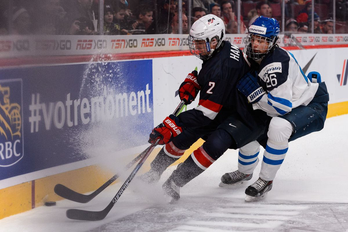 MONTREAL, QC - DECEMBER 26: Sebastian Aho #26 of Team Finland versus Noah Hanifin #2 of Team United States during the 2015 IIHF World Junior Hockey Championship game at the Bell Centre on December 26, 2014 in Montreal, Quebec, Canada