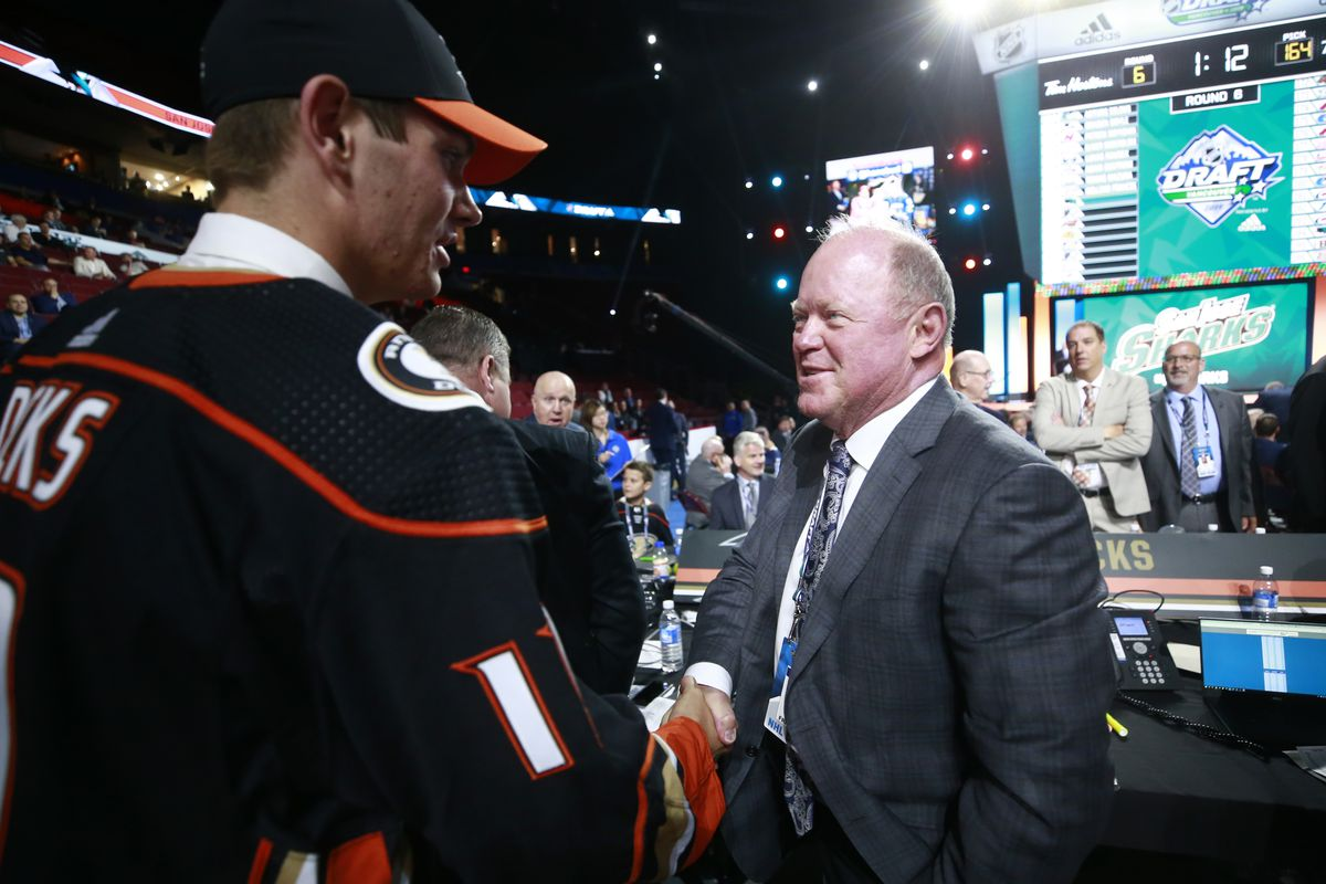 William Francis, 163rd overall pick of the Anaheim Ducks, is greeted by general manager Bob Murray on the draft floor during Rounds 2-7 of the 2019 NHL Draft at Rogers Arena on June 22, 2019 in Vancouver, Canada.