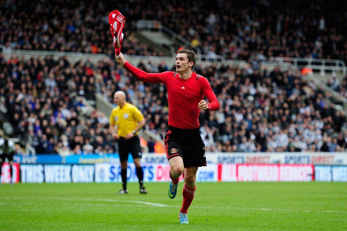 Johnson celebrates his derby day goal in April 2013