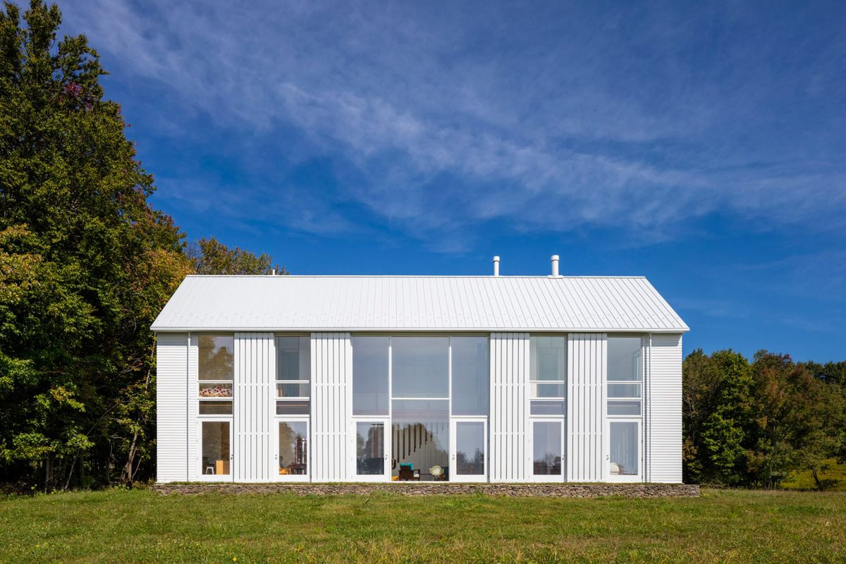 Exquisite Modern Farmhouse Uses Massive Rolling Shutters