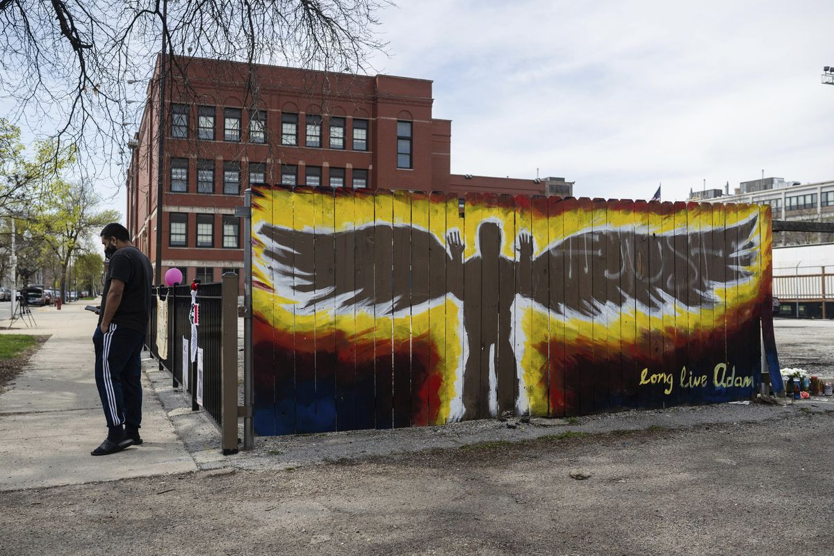 Memorial for 13-year-old Adam Toledo painted on the fence next to the spot where he was fatally shot by a Chicago police officer on March 29, 2021.