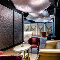 Tucked away in the corridor of the private bar, a soft and voluminous custom tulle sculpture hovers above.
