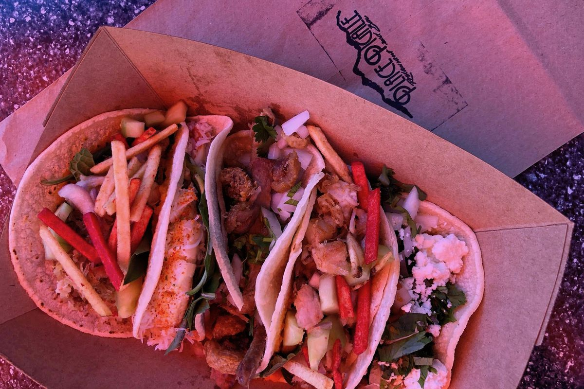 Several octopus tacos over a napkin that says Place Pigalle