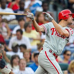 Philadelphia Phillies' Cole Hamels, right, hits a two-RBI double in the third inning of a baseball game against the Atlanta Braves, Sunday, Sept. 2, 2012, in Atlanta.