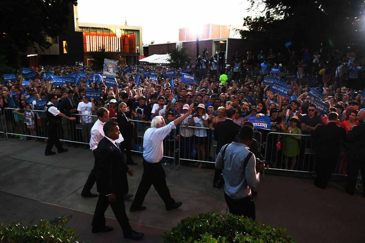 Bernie Sanders waves to a crowd
