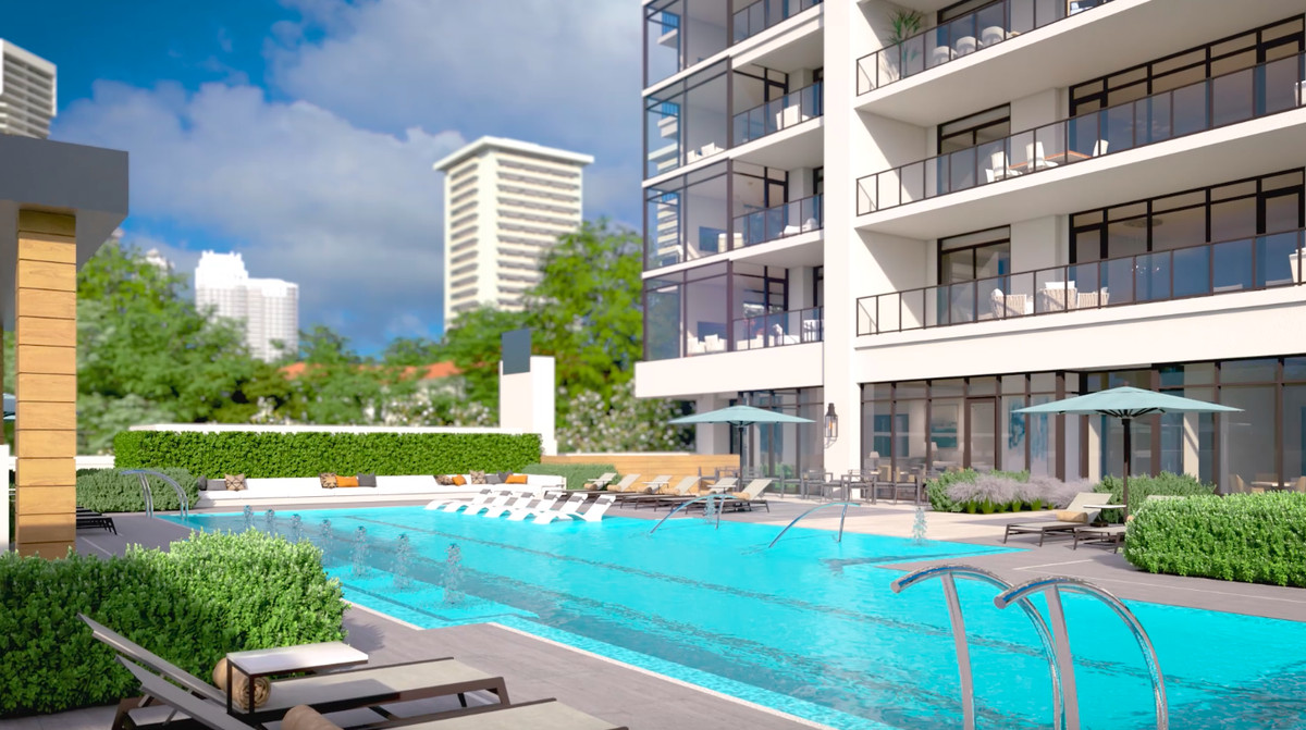 A rendering of a pool area with buildings in the background.