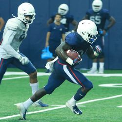 The UConn Huskies football team practices in the Shenkman Training Center in the Burton Family Football Complex on August 15, 2018.