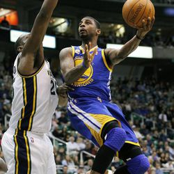 Golden State Warriors small forward Dorell Wright (1) attempts to score past Utah Jazz center Al Jefferson (25) during the first half of an NBA basketball game, Friday, April 6, 2012, in Salt Lake City.  (AP Photo/Colin E Braley)
