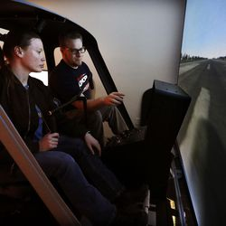 Students Maya Dickemore and Jared Steffen train in a helicopter simulator at Salt Lake Community College's Westpointe Center in Salt Lake City on Wednesday, Dec. 9, 2015.