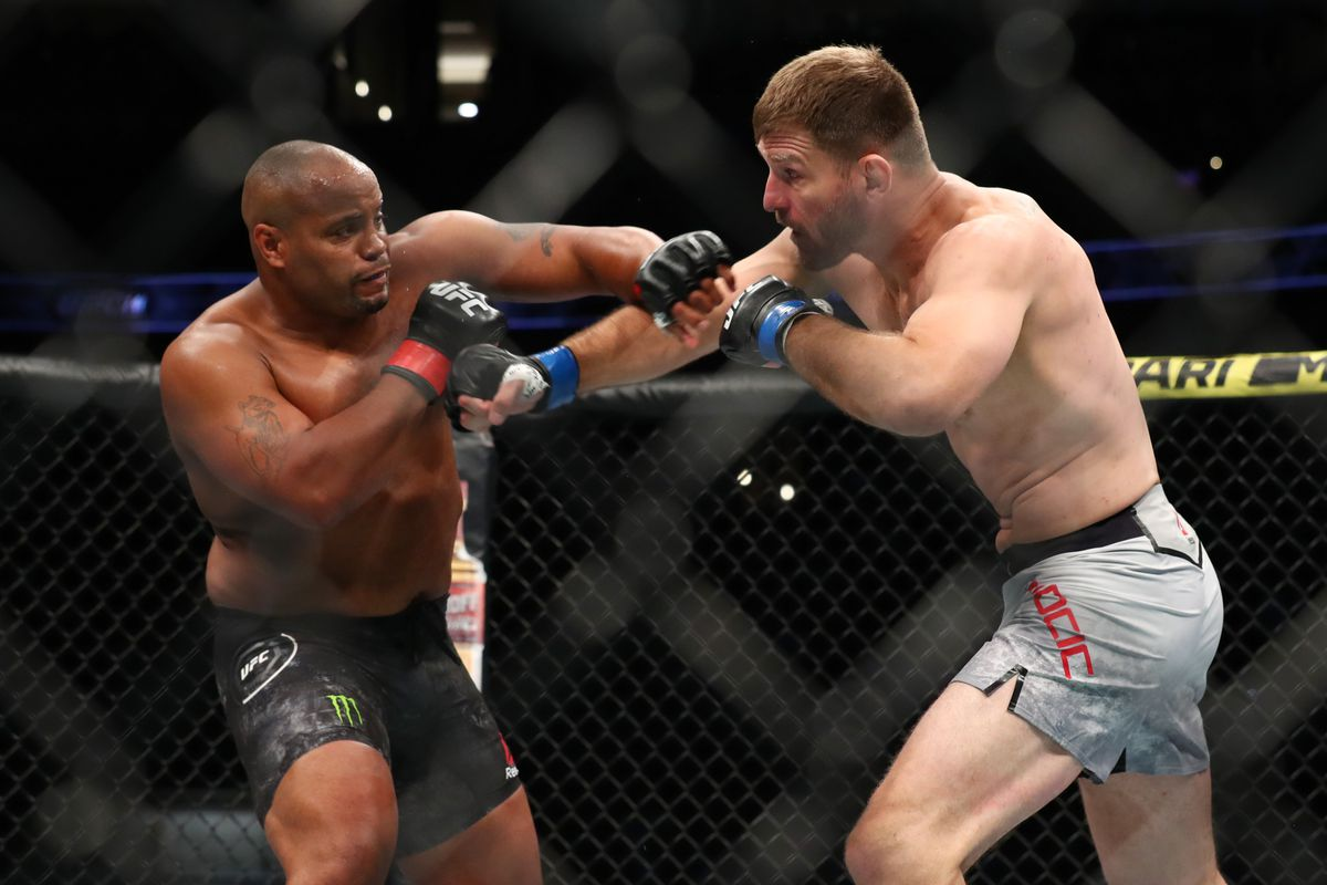 Daniel Cormier throws a punch at Stipe Miocic in the first round during their UFC Heavyweight Title Bout at UFC 241 at Honda Center on August 17, 2019 in Anaheim, California.