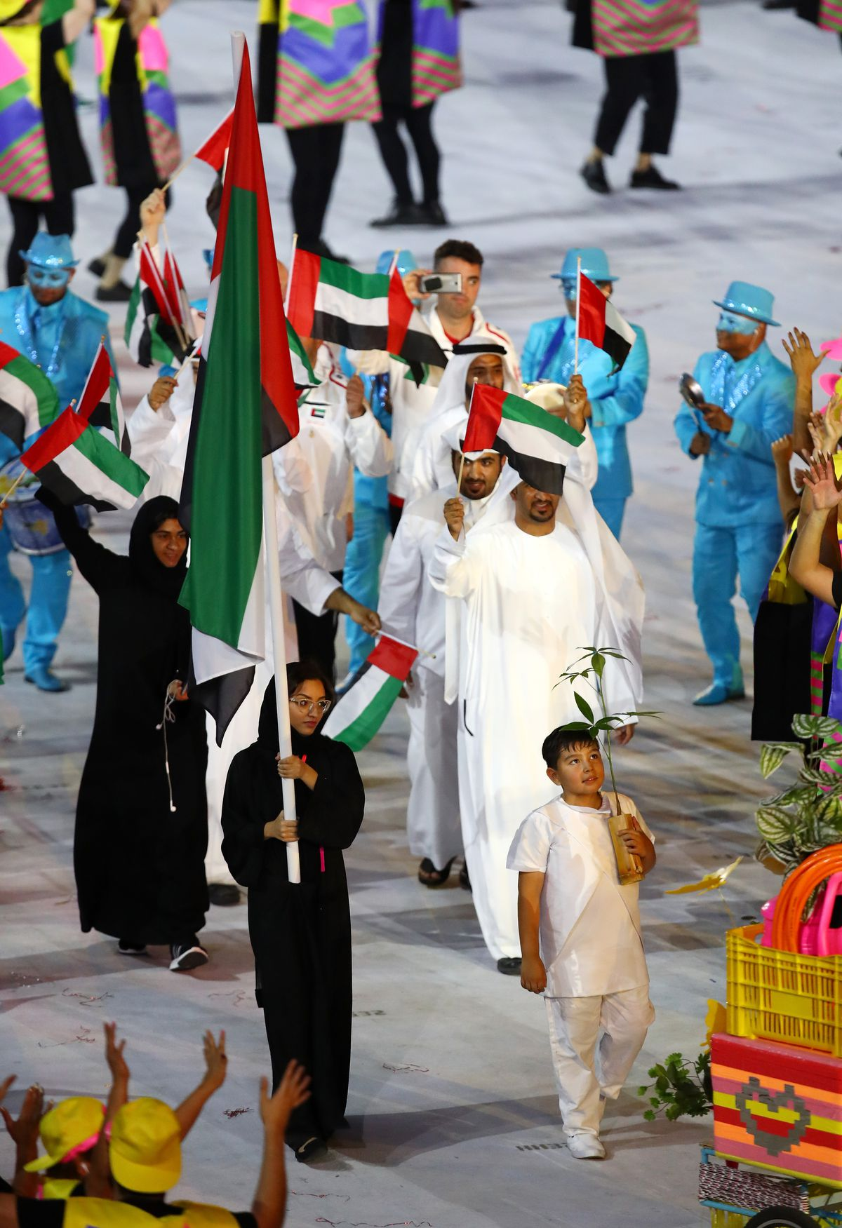 Nada Al-Bedwawi carries UAE's flag in the Opening Ceremony of the Olympics
