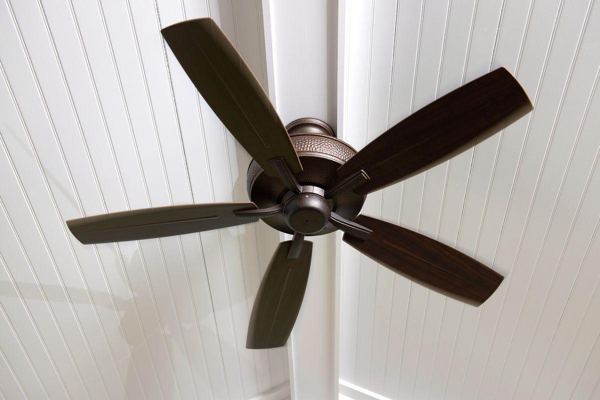 Ceiling fan on white beadboard ceiling.