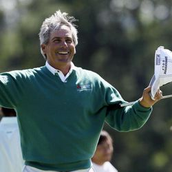 Fred Couples celebrates after finishing the second round the Masters golf tournament on the 18th hole Friday, April 6, 2012, in Augusta, Ga.