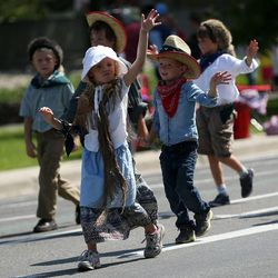 Children march behind the Salt Lake Hillside Stake float in the Days of '47 Youth Parade in Salt Lake City on Saturday, July 20, 2013.