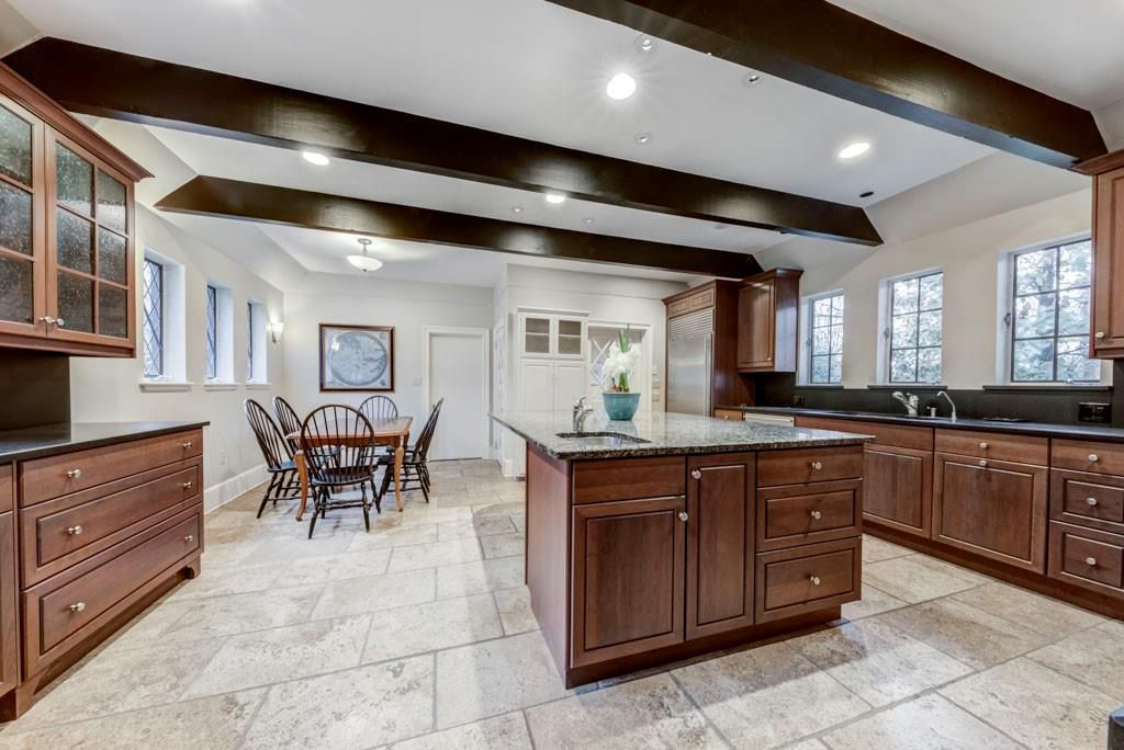 A huge kitchen with much wood.