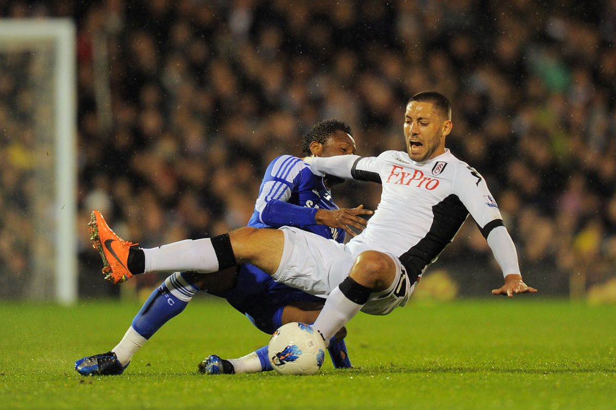 LONDON, ENGLAND - APRIL 09: Clint Dempsey of Fulham is challenged by Mikel of Chelsea during the Barclays Premier League match between Fulham and Chelsea at Craven Cottage on April 9, 2012 in London, England.  (Photo by Mike Hewitt/Getty Images)