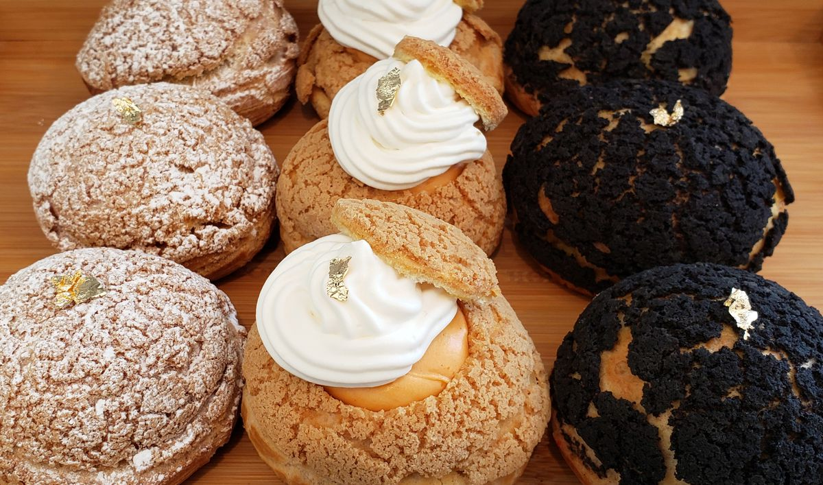 Cream puffs topped with gold leaf