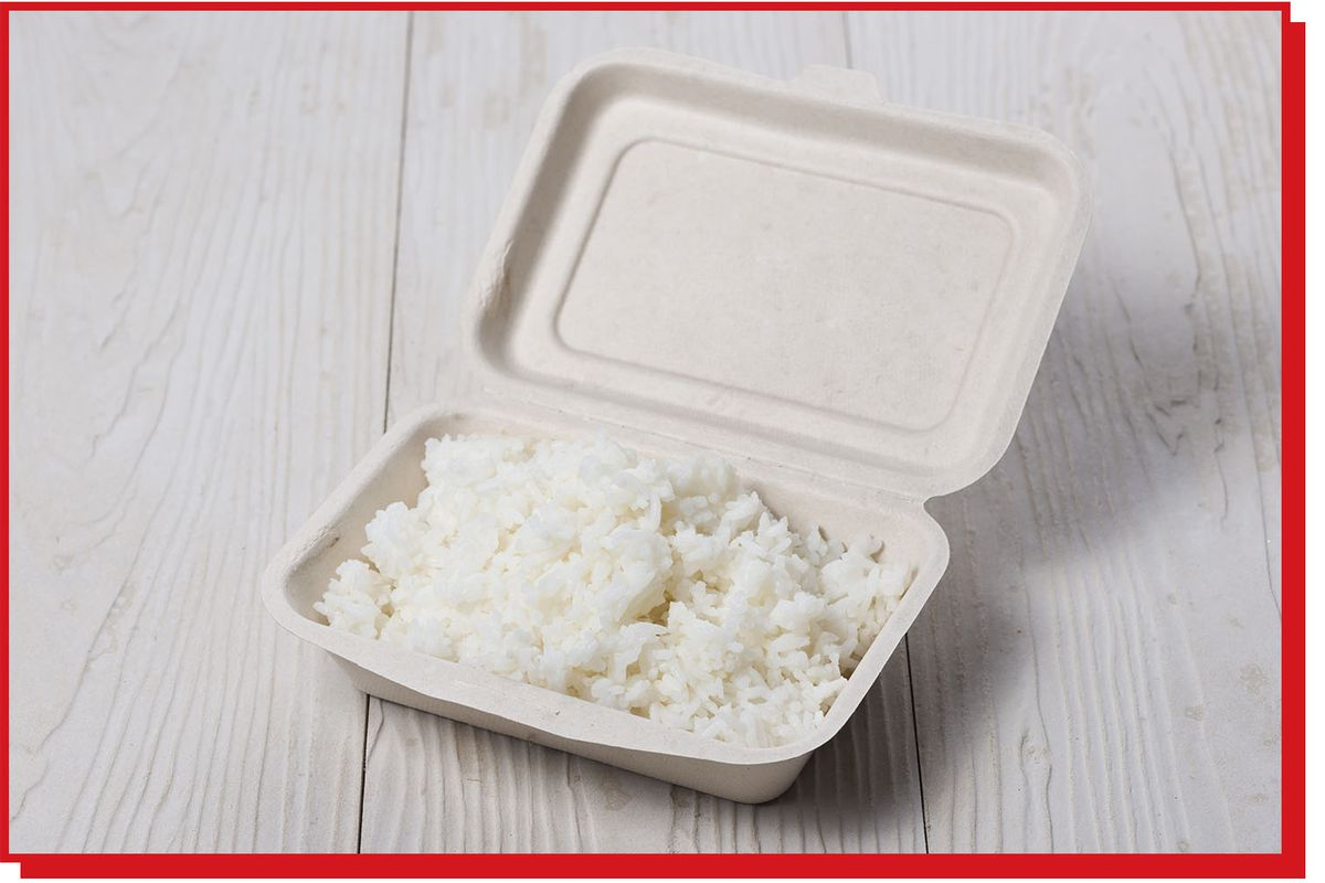 Cardboard takeout container containing white rice.