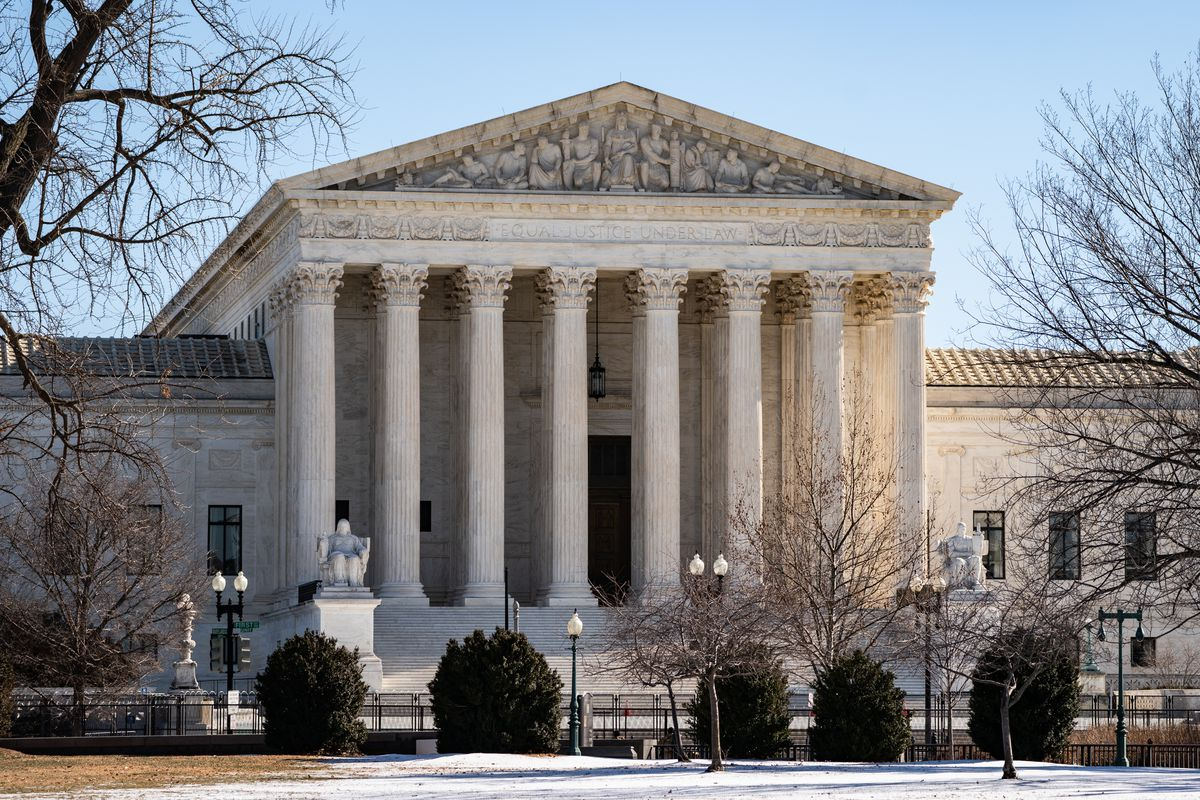 A picture of the United States Supreme Court. Barricades are seen that were erected after the January 6 attack on the US Capitol building.