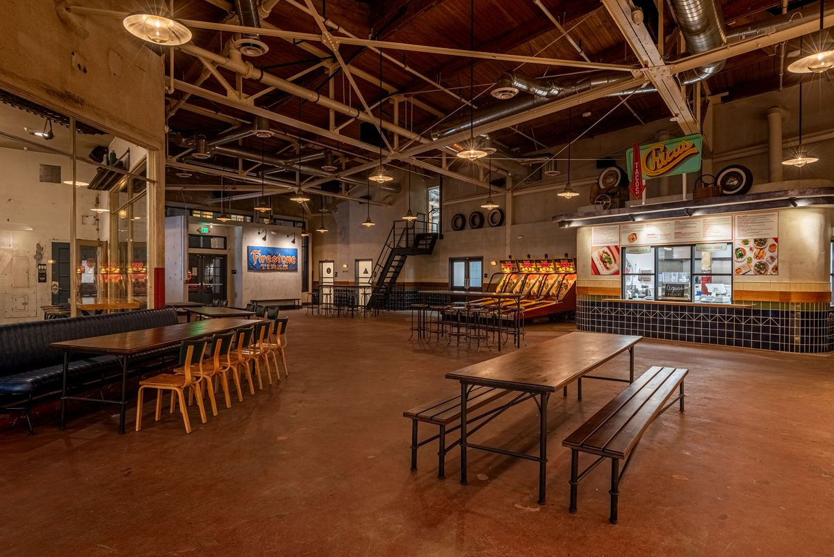 Games and long tables inside of a redone warehouse brewery.