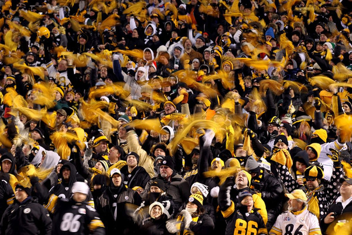 PITTSBURGH PA - JANUARY 23:  Pittsburgh Steelers fans wave terrible towels during their 2011 AFC Championship game against the New York Jets at Heinz Field on January 23 2011 in Pittsburgh Pennsylvania.  (Photo by Al Bello/Getty Images)