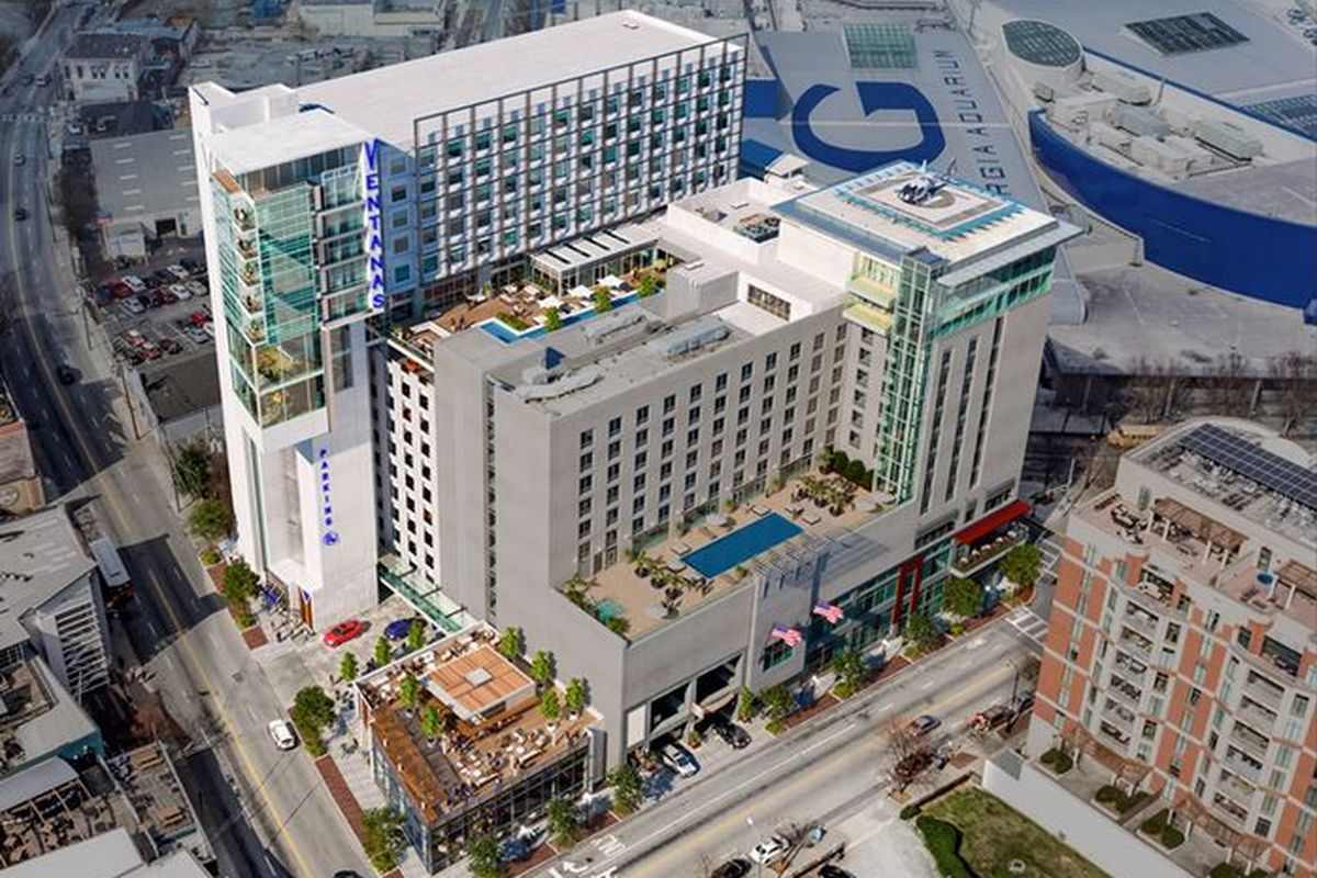 A rendering of the a very modern hotel that shoots up from the roof of the parking deck.