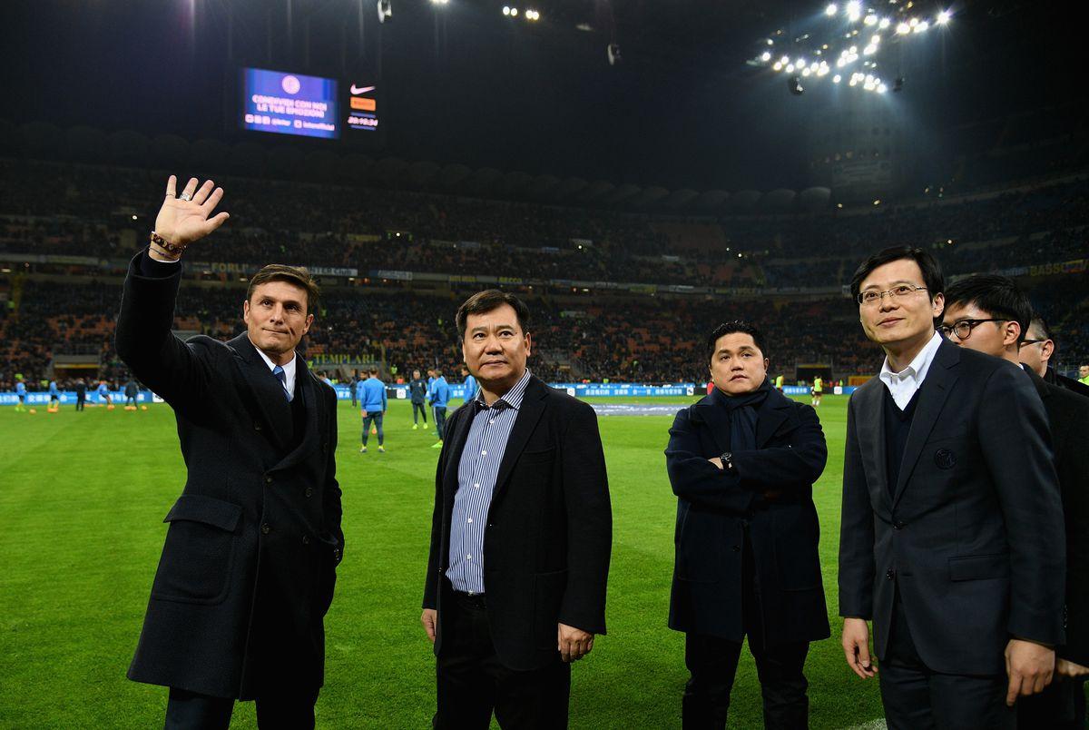 Zhang Jindong next to Erick Thohir