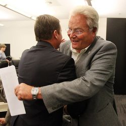 President Dale Cox, right, of the Utah AFL-CIO greets Government Affairs Manager Stan Lockhart of IM Flash Technologies following a roundtable in Cottonwood Heights, Thursday, Nov. 20, 2014, concerning immigration reform.