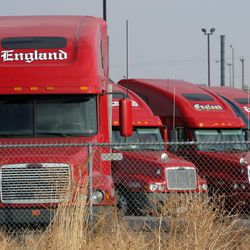"""Semis parked at the C.R. England's headquarters in Salt Lake City on Tuesday, December 13, 2005. Critics worry that House Bill 251 Post-Employment Restrictions Amendments would stifle expansion in several of the state""""™s fastest growing industries, including technology, biotech, healthcare, transportation and media, among others."""