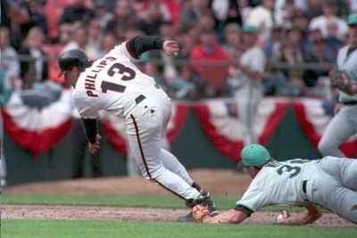 Bobby Witt(R) of the Florida Marlins tags the foot