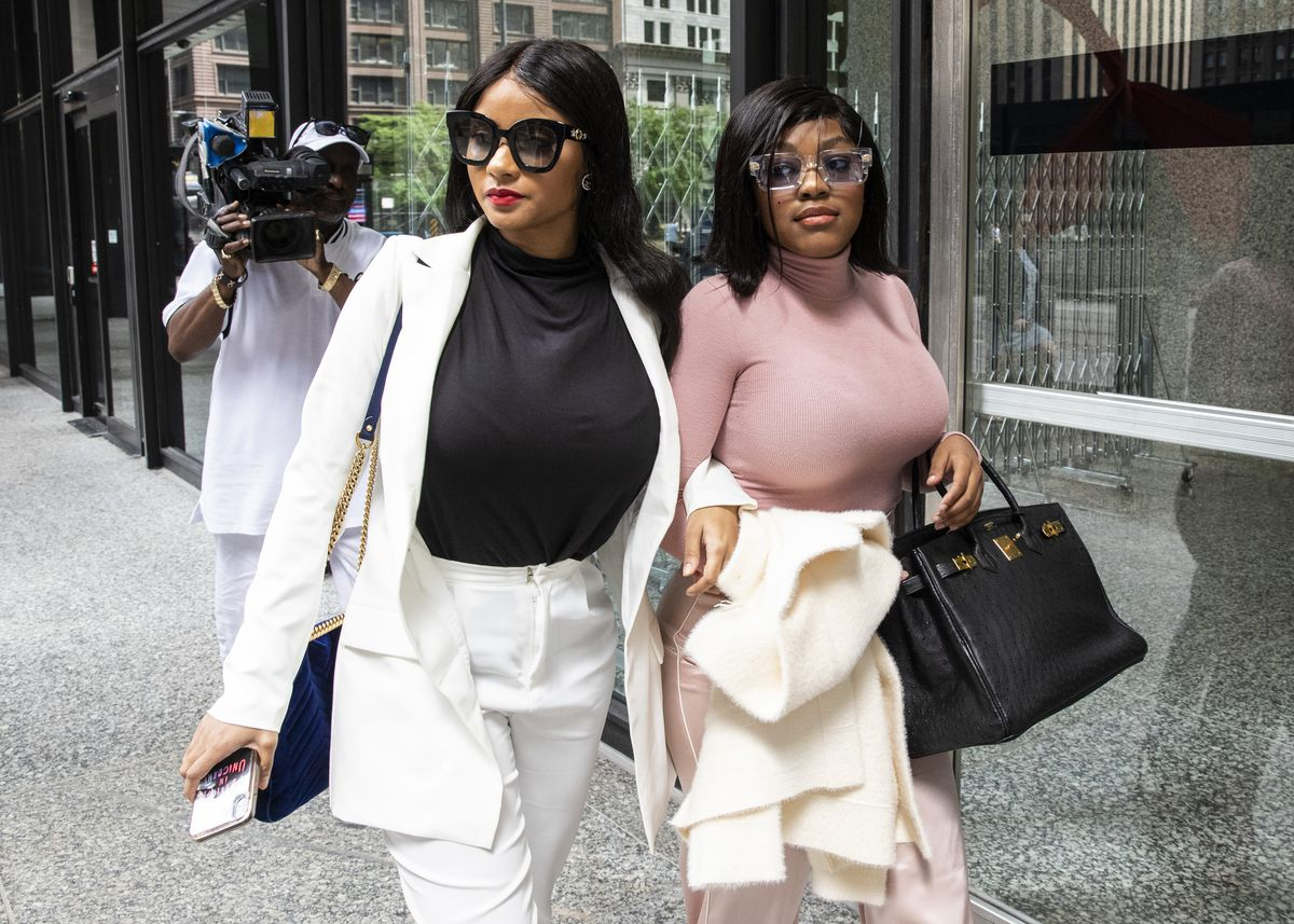Joycelyn Savage, left, and Azriel Clary walk out of the Dirksen Federal Courthouse after a court appearance by R. Kelly earlier this year.