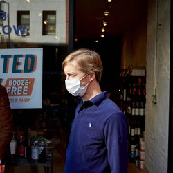 Douglas Watters stands outside Spirited Away, an alcohol-free bottle shop, in the Lower East Side of Manhattan in New York on Saturday, March 13, 2021. The shop is devoted to everything needed to make alcohol-free cocktails.
